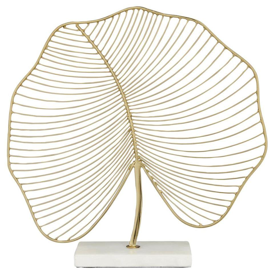 """<p><a rel=""""nofollow noopener"""" href=""""https://www.johnlewis.com/john-lewis-wire-leaf-marble-base-ornament-gold/p3310552"""" target=""""_blank"""" data-ylk=""""slk:BUY NOW"""" class=""""link rapid-noclick-resp"""">BUY NOW</a> <strong>John Lewis, £25</strong></p><p>Perfect for a bookshelf or windowsill in a new home, this gold-finish leaf sculpture, handmade in India, is skilfully crafted from iron to achieve a fine and elegant shape. </p>"""