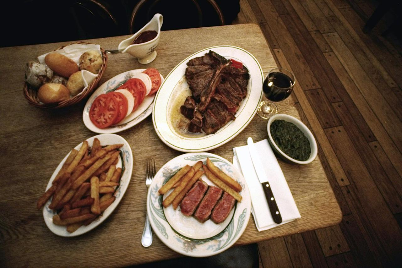"""<strong>The Reviewer: </strong>Pete Wells, <em>The New York Times</em><strong> Choice Cuts: </strong>Wells has not always hated the well-known steakhouse. At the start of his <a href=""""https://www.nytimes.com/2019/10/29/dining/peter-luger-review-pete-wells.html"""">brutal zero-star review</a>, he recalls happily emptying out his wallet to eat one of their sizzling porterhouse or rib steaks in the 1990s. """"Because a Peter Luger steak made me feel alive in a way that few other things did, I considered this a fair trade."""" But a visit back in October 2019, did not encourage the same exchange. He likens the shrimp cocktail to """"cold latex dipped in ketchup and horseradish,"""" calls the dole """"dry and almost powder,"""" and the Caesar salad """"drippy"""" with croutons straight out of the bag. """"I know there was a time the German fried potatoes were brown and crunchy, because I eagerly ate them each time I went,"""" he writes. """"Now they are mushy, dingy, gray and sometimes cold. I look forward to them the way I look forward to finding a new, irregularly shaped mole."""" His porterhouse was equally disappointing. Though he """"could live"""" with its ranging degree of doneness despite his request for medium-rare, Wells still called the meat """"far from the best New York has to offer."""" <strong>The Pièce de Résistance: </strong>""""There is almost always a wait, with or without a reservation, and there is almost always a long line of supplicants against the wall. A kind word or reassuring smile from somebody on staff would help the time pass. The smile never comes. The Department of Motor Vehicles is a block party compared with the line at Peter Luger."""""""