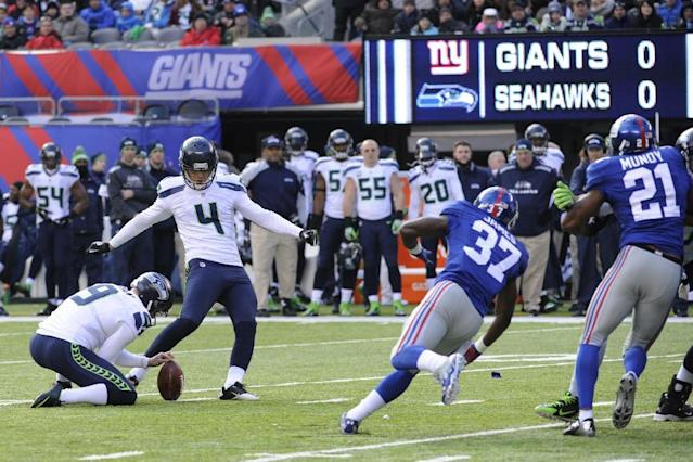 Seattle Seahawks kicker Steven Hauschka (4), with Jon Ryan holding, kicks a field goal against the New York Giants during the first half of an NFL football game, Sunday, Dec. 15, 2013, in East Rutherford, N.J. (AP Photo/Bill Kostroun)