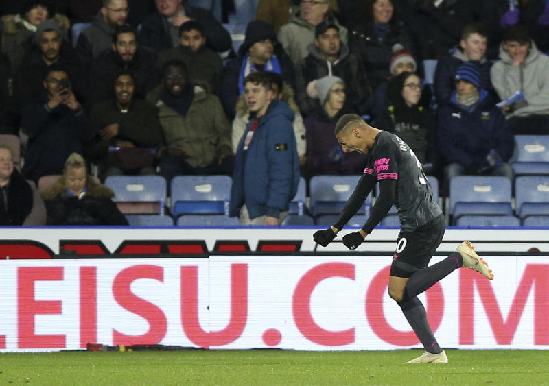 Everton's Richarlison celebrates scoring his side's first goal of the game against Huddersfield Town during their English Premier League soccer match at the John Smith's Stadium in Huddersfield, England, Tuesday Jan. 29, 2019. (Nigel French/PA via AP)