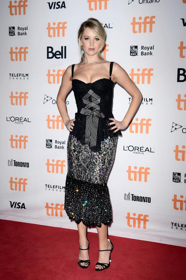 <p>The actress went for a more sultry look with a corseted Dolce & Gabbana dress featuring a sequinned mermaid skirt.<br /><i>[Photo: Getty]</i> </p>