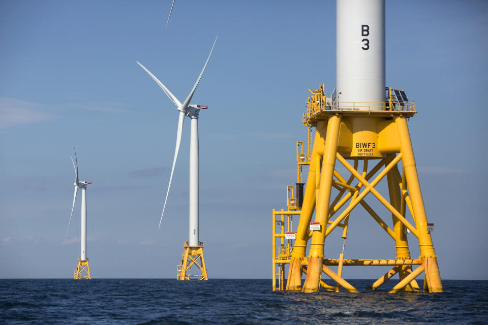 FILE - In this Aug. 15, 2016 file photo, three of Deepwater Wind's five turbines stand in the water off Block Island, R.I, the nation's first offshore wind farm. California and the federal government have agreed to open up areas off the central and northern coasts to massive wind farms. The pact announced Tuesday, May 25, 2021, that would float hundreds of turbines off the coast of Morro Bay and Humboldt Bay was touted as a breakthrough to eventually power 1.6 million homes. (AP Photo/Michael Dwyer, File)