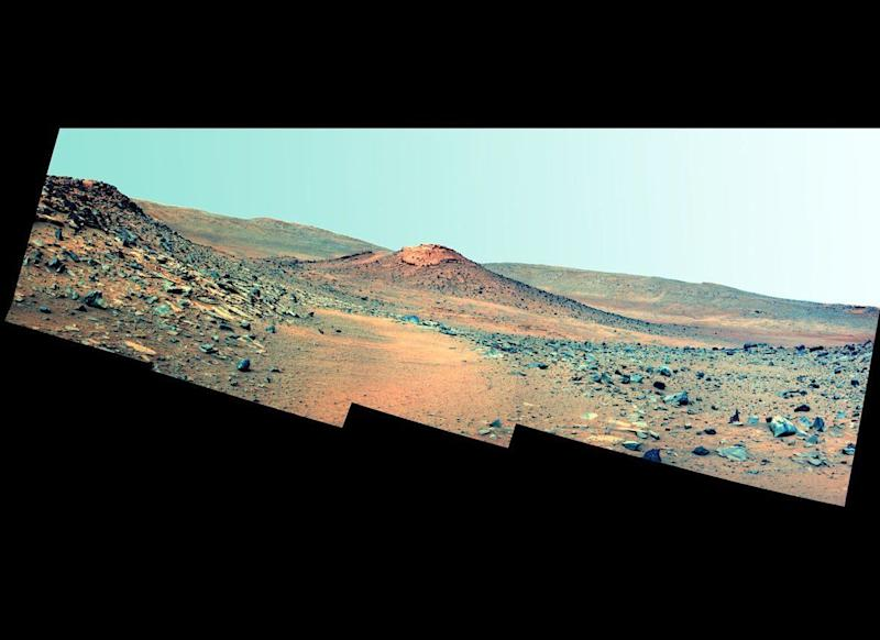 "This Spirit Pancam false-color postcard, taken on mission sol 2114 (January 4, 2010) shows a volcanic hill called Von Braun, which could be the rover's next exploration target once the rover emerges from its long winter hibernation. <em>From ""Postcards from Mars"" by Jim Bell; Photo credit: NASA/JPL/Cornell University </em>"