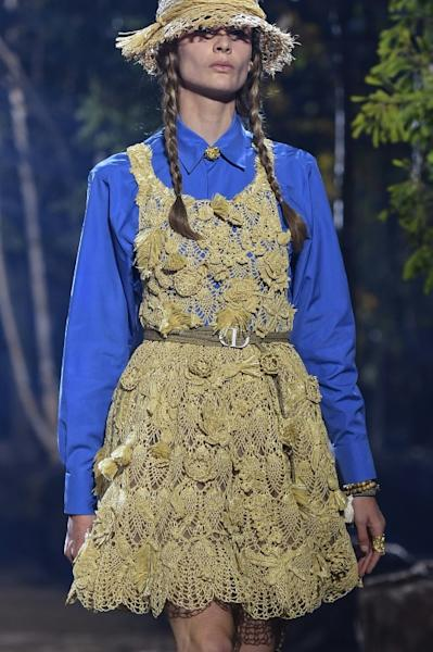 A model in Greta Thunberg-style plaits and an eco-friendly raffia dress during Dior's Paris women's fashion week show in September