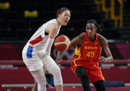 South Korea's Ji Su Park (19), left, and Spain's Astou Ndour (45) fight for loose ball during women's basketball preliminary round game at the 2020 Summer Olympics, Monday, July 26, 2021, in Saitama, Japan. (AP Photo/Charlie Neibergall)