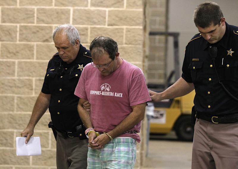 Amarillo plastic surgeon Thomas Michael Dixon is escorted into the Lubbock County Detention Center in Lubbock, Texas, Monday, July 16, 2012.  Dixon and David Neal Shepard have been charged in Dr. Joseph Sonnier III's death in an alleged murder-for-hire plot. (AP Photo/Lubbock Avalanche-Journal,Zach Long)