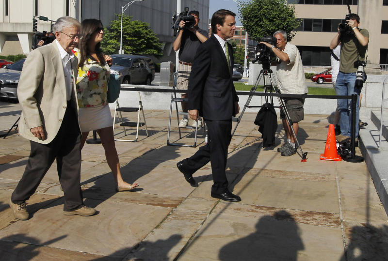 Former Sen. John Edwards, right, leads his father Wallace Edwards and daughter Cate Upham into the Federal Courthouse in Greensboro, N.C. Wednesday, May 2, 2012. Edwards is accused of conspiring to secretly obtain more than $900,000 from two wealthy supporters to hide his extramarital affair with Rielle Hunter and her pregnancy from the media. He has pleaded not guilty to six charges related to violations of campaign-finance laws. (AP Photo/The News & Observer, Chuck Liddy) MANDATORY CREDIT