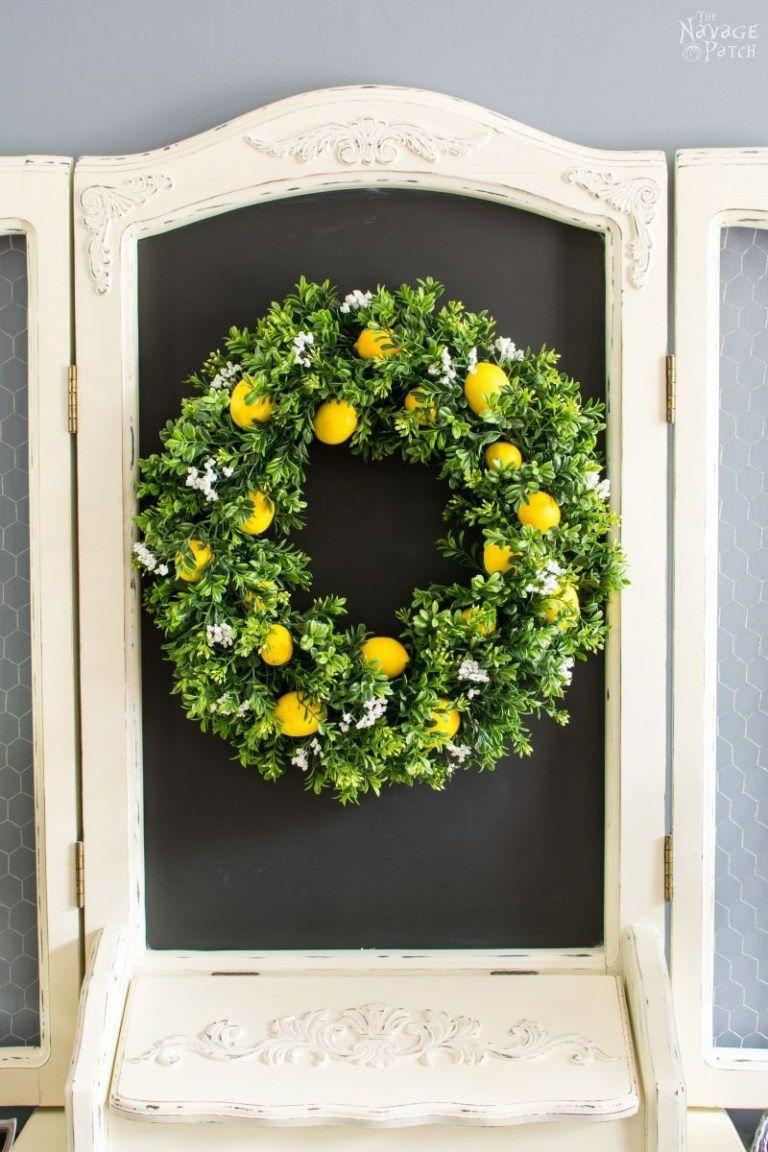 "<p>A little color from faux lemons make this wreath really pop.</p><p><strong>Get the tutorial at <a href=""http://www.thenavagepatch.com/diy-summer-lemon-wreath/"" rel=""nofollow noopener"" target=""_blank"" data-ylk=""slk:The Navage Patch"" class=""link rapid-noclick-resp"">The Navage Patch</a>. </strong><br></p><p><a class=""link rapid-noclick-resp"" href=""https://go.redirectingat.com?id=74968X1596630&url=https%3A%2F%2Fwww.michaels.com%2Fdefault%2F10131588.html%23start%3D16&sref=https%3A%2F%2Fwww.countryliving.com%2Fdiy-crafts%2Fg4395%2Fsummer-wreaths%2F"" rel=""nofollow noopener"" target=""_blank"" data-ylk=""slk:SHOP MINI LEMONS"">SHOP MINI LEMONS</a> </p>"