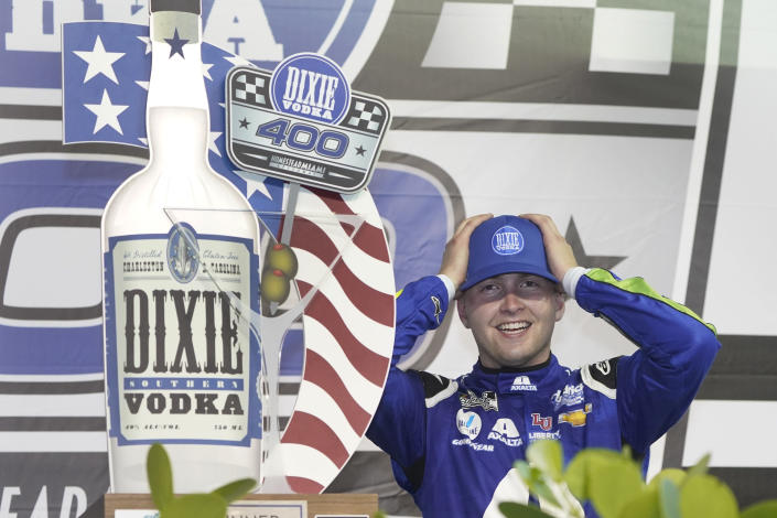 William Byron adjusts his cap as he celebrates after winning a NASCAR Cup Series auto race, Sunday, Feb. 28, 2021, in Homestead, Fla. (AP Photo/Wilfredo Lee)