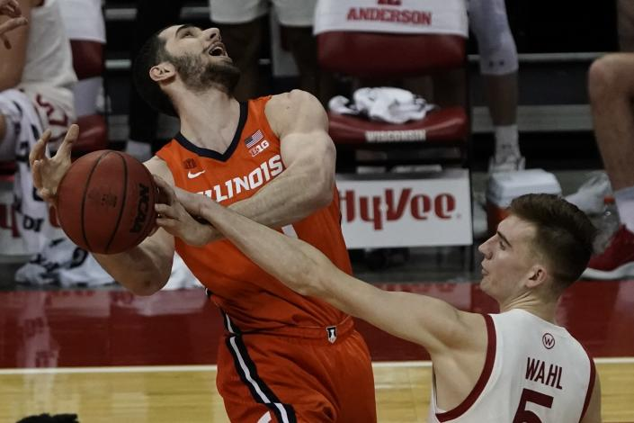 Wisconsin's Tyler Wahl blocks the shot of Illinois's Giorgi Bezhanishvili during the first half of an NCAA college basketball game Saturday, Feb. 27, 2021, in Madison, Wis. (AP Photo/Morry Gash)