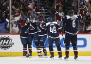 Colorado Avalanche left wing Andre Burakovsky, second from left, celebrates hia goal with, from left, centers T.J. Tynan and Vladislav Kamenev and defensemen Samuel Girard and Erik Johnson sueinf the second period of the team's NHL hockey game against the Nashville Predators on Thursday, Nov. 7, 2019, in Denver. (AP Photo/David Zalubowski)