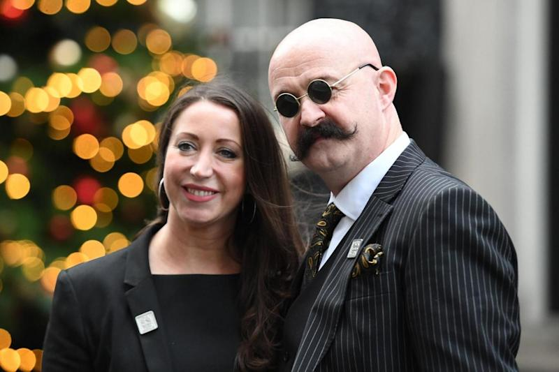 Paula Williamson, the wife of prisoner Charles Bronson, stands in Downing Street, London, with a Charles Bronson look-alike (PA Archive/PA Images)