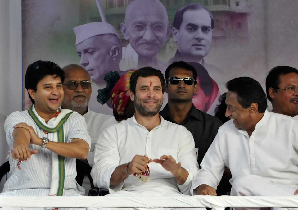 INDORE, INDIA - OCTOBER 24: Congress Vice-President Rahul Gandhi chats with Congress leaders Jyotiraditya Scindia and Kamal Nath at a public rally on October 24, 2013 in Indore, India. Addressing election rally Rahul Gandhi today claimed that if voted to power Congress will make Indore commercial capital of country.  (Photo by Arun Mondhe/Hindustan Times via Getty Images)