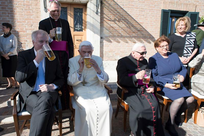 Pope Emeritus Benedict XVI toasts his 90th birthday  - AP