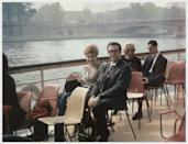 <p>British comedic actor Peter Sellers and Audrey Stark take it easy on a sightseeing trip down the Seine River. The Polaroid was taken by his <em>Pink Panther</em> costar, and Audrey's husband, Graham Stark.</p>