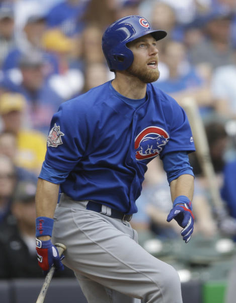 Chicago Cubs' Ben Zobrist watches his home run against the Milwaukee Brewers during the seventh inning of a baseball game Sunday, April 9, 2017, in Milwaukee. (AP Photo/Jeffrey Phelps)