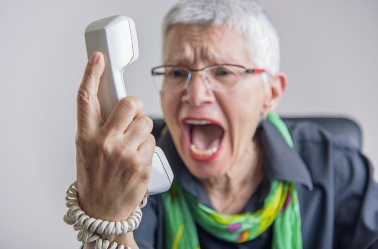 """<span class=""""caption"""">Scammers play on people's vulnerabilities – don't get caught out.</span> <span class=""""attribution""""><a class=""""link rapid-noclick-resp"""" href=""""https://www.shutterstock.com/image-photo/angry-enraged-senior-woman-yelling-landline-644165242"""" rel=""""nofollow noopener"""" target=""""_blank"""" data-ylk=""""slk:TeodorLazarev/Shutterstock"""">TeodorLazarev/Shutterstock</a></span>"""