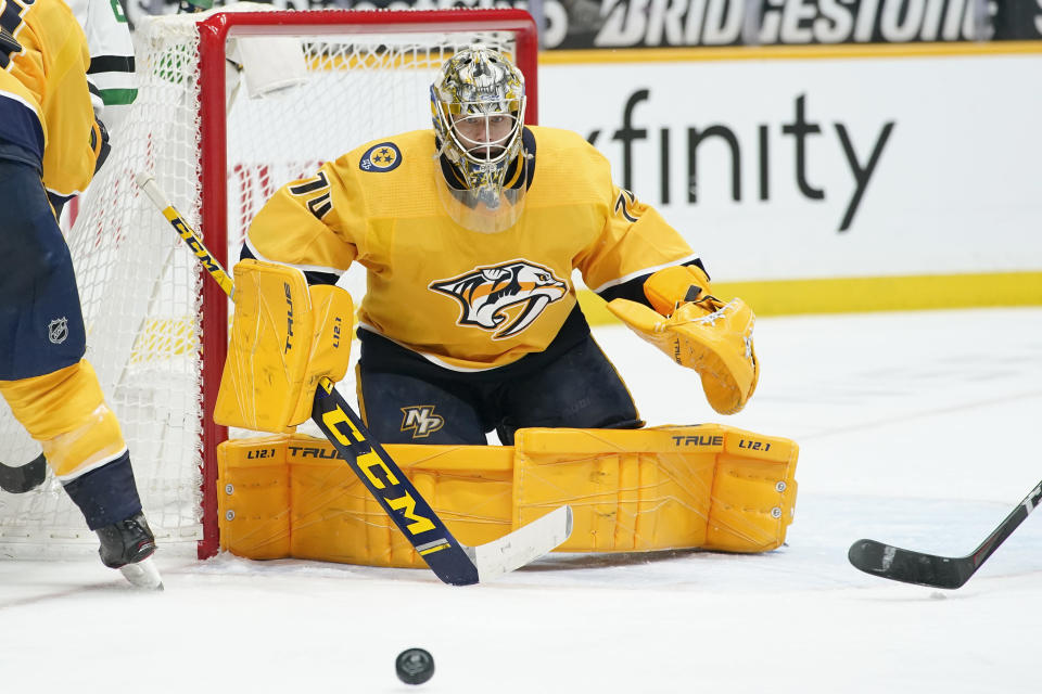FILE - In this Saturday, May 1, 2021 file photo ,Nashville Predators goaltender Juuse Saros (74) blocks a shot against the Dallas Stars in the third period of an NHL hockey game in Nashville, Tenn. Goalie Juuse Saros is the biggest reason the Nashville Predators went from a potential NHL draft lottery team to their seventh straight playoff appearance. How long they stick around will depend on just how well Saros keeps playing in net.(AP Photo/Mark Humphrey, File)