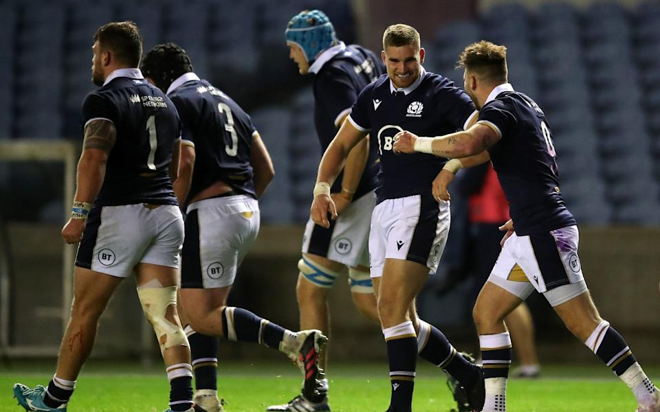 Scotland captain Fraser Brown (centre) helped himself to two tries - PA