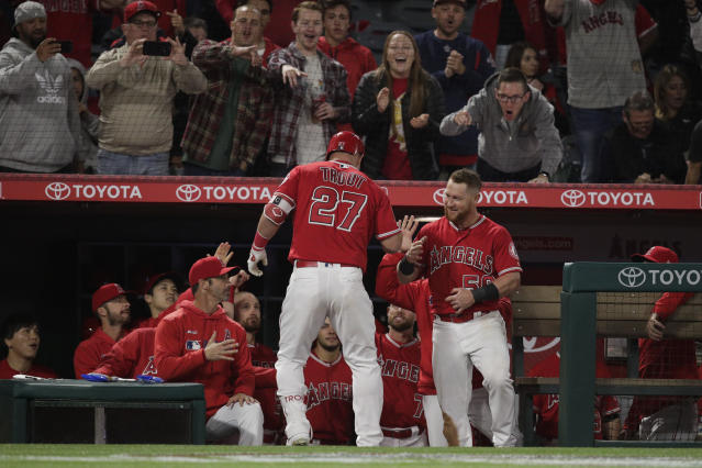 Los Angeles Angels' Mike Trout, center, celebrates his home run with teammates during the sixth inning of a baseball game against the Texas Rangers, Friday, April 5, 2019, in Anaheim, Calif. (AP Photo/Jae C. Hong)