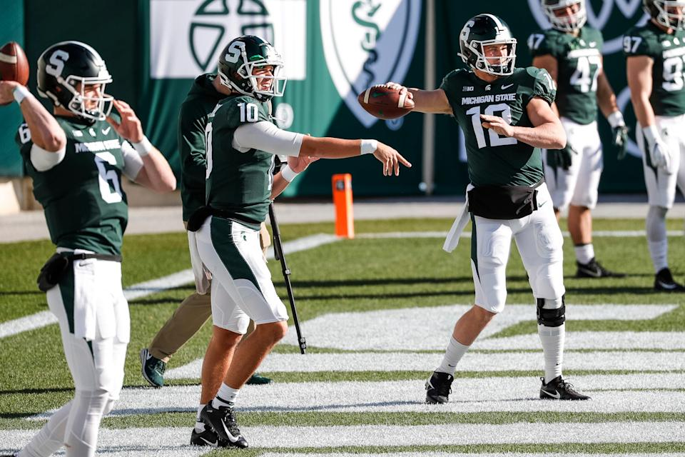 Michigan State quarterbacks Theo Day (6), Payton Thorne (10) and quarterback Rocky Lombardi (12) warm up ahead of the Indiana game at Spartan Stadium in East Lansing, Saturday, Nov. 14, 2020.