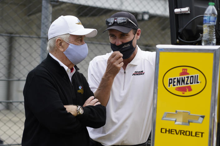 Roger Penske, left, talks with Tim Cindric during practice for the Indianapolis 500 auto race at Indianapolis Motor Speedway, Wednesday, May 19, 2021, in Indianapolis. (AP Photo/Darron Cummings)