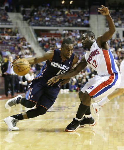 Charlotte Bobcats guard Kemba Walker (15) drives on Detroit Pistons guard Will Bynum (12) during the first half of an NBA basketball game at the Palace in Auburn Hills, Mich., Friday, April 12, 2013. (AP Photo/Carlos Osorio)