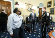 Chairman Raúl Grijalva, D-Ariz., left, speaks with Acting U.S. Park Police Chief Gregory T. Monahan, prior to a House Natural Resources Committee hearing on actions taken on June 1, 2020 at Lafayette Square, Tuesday, July 28, 2020 on Capitol Hill in Washington. (Bill Clark/Pool via AP)