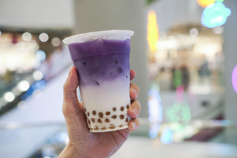 Purple Sweet Potato with golden bubble. A cup of purple sweet potato latte with milk and golden bubble.