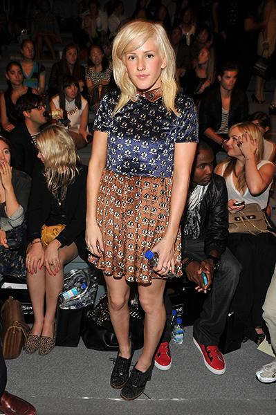 """<div class=""""caption-credit""""> Photo by: Getty Images</div><div class=""""caption-title"""">In the front row of the Charlotte Ronson Spring 2012 show</div>This printed brown and navy dress with it's Peter Pan collar is just the right amount of twee, while her slightly-sparkly oxford booties lend a bit of a rockabilly charm to the completed look."""