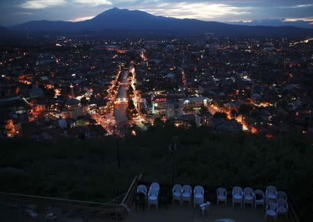 Seats are placed before the screening of a film in an open-air cinema on the medieval Prizren fortress during Dokufest in Prizren, southwest of capital Pristina August 20, 2014. REUTERS/Hazir Reka