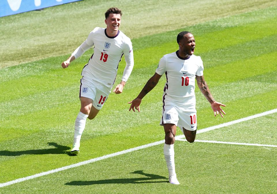 England's Raheem Sterling (right) celebrates scoring their side's first goal of the game during the UEFA Euro 2020 Group D match at Wembley Stadium, London. Picture date: Sunday June 13, 2021.