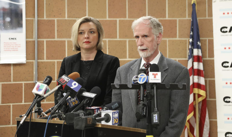 Dr. Tom Wake, the interim administrator of Cook County Animal and Rabies Control, speaks with reporters in Chicago, Thursday, Jan. 9, 2020, while Kelley Gandurski, executive director of the Chicago Animal Care and Control, stands next to him. Authorities were on the hunt for coyotes in downtown Chicago after two reported attacks, including one where passersby said they had to pull a wild canine off of a 6-year-old boy who was bitten in the head. (AP Photo/Teresa Crawford)