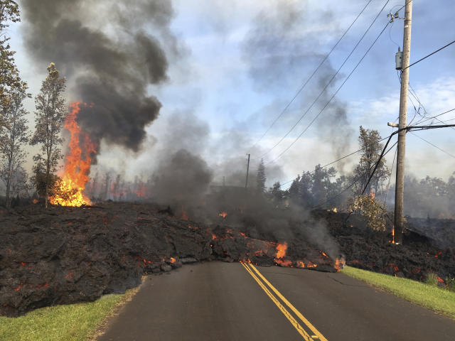 <p>In this Saturday, May 5, 2018, photo provided by the U.S. Geological Survey, lava from Fissure 7 slowly advances to the northeast on Hookapu Street in the Leilani Estates subdivision in Pahoa, Hawaii. (Photo: U.S. Geological Survey via AP) </p>