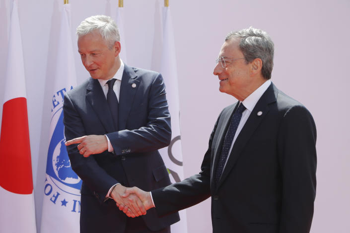 French Finance Minister Bruno Le Maire, left, welcomes European Central Bank President Mario Draghi at the G-7 Finance Wednesday July 17, 2019.The top finance officials of the Group of Seven rich democracies are arriving at Chantilly, at the start of a two-day meeting aimed at finding common ground on how to tax technology companies and on the risk from new digital currencies. (AP Photo/Michel Euler)