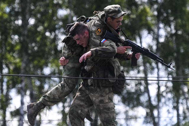 <p>Servicemen of the Russian Armed Forces during the Scout Trail obstacle course, a stage of the Army Scout Masters competition among reconnaissance units, as part of the 2018 International Army Games at the Koltsovo range in Novosibirsk region, Russia on Aug. 2, 2018. (Photo: Kirill Kukhmar/TASS via Getty Images) </p>