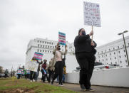 FILE - In this Tuesday, March 2, 2021 file photo, protestors in support of transgender rights march around the Alabama State House in Montgomery, Ala. Pride Month celebrations in the U.S. are taking place under unusual circumstances in June 2021, with pandemic-related concerns disrupting many of the usual festivities and political setbacks dampening the mood of LGBTQ-rights activists. (Jake Crandall//The Montgomery Advertiser via AP, File)=ALMON