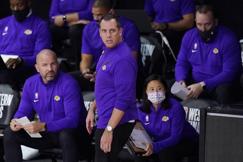Los Angeles Lakers head coach Frank Vogel, center, watches the action during the first half of an NBA conference final playoff basketball game between the Lakers and the Denver Nuggets Saturday, Sept. 26, 2020, in Lake Buena Vista, Fla. (AP Photo/Mark J. Terrill)