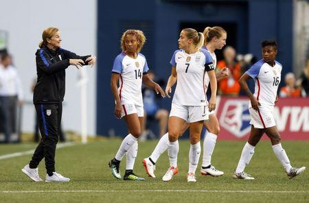 Jul 27, 2017; Seattle, WA, USA; USA head coach Jill Ellis speaks with her player including defender Alanna Kennedy (19) and defender Steph Catley (7) during the second half against Australia at Century Link Field. Mandatory Credit: Joe Nicholson-USA TODAY Sports