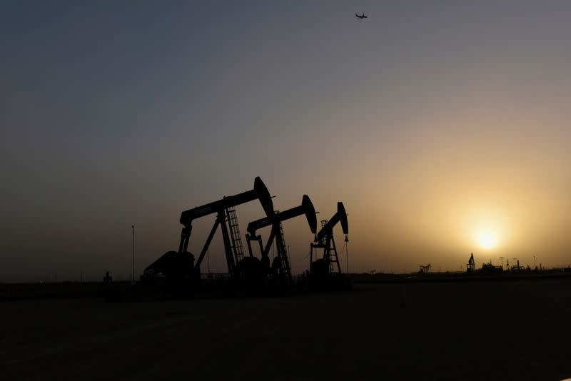 Oil rises seven-month high, Wall Street stocks fall