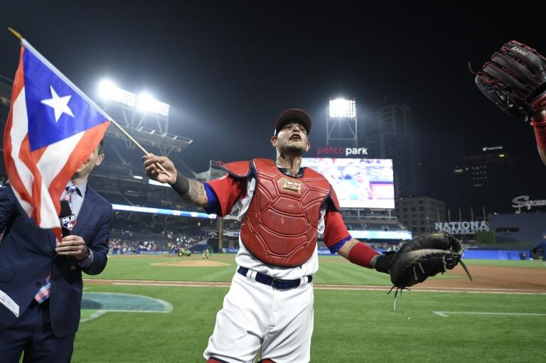 Yadier Molina of Puerto Rico celebrates after beating the Dominican Republic 3-1 in their World Baseball Classic Pool F game, at PETCO Park in San Diego, California, on March 14, 2017