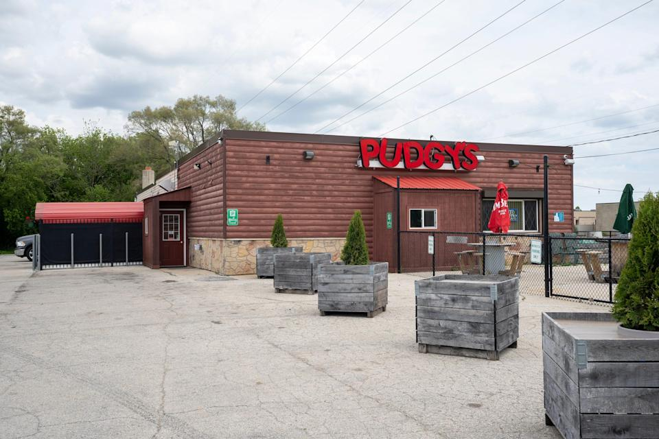 """Pudgy's, the bar where Kyle Rittenhouse was seen on Jan. 5, 2021, taking pictures with Proud Boys and flashing the """"OK"""" symbol that has been used as a symbol of white supremacy, had just a handful of regulars at the bar on a recent Thursday morning."""