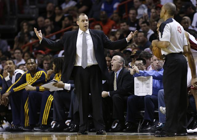 Indiana Pacers coach Frank Vogel talks to an official during the first half of the Pacers' NBA basketball game against the Miami Heat, Friday, April 11, 2014, in Miami. (AP Photo/Lynne Sladky)