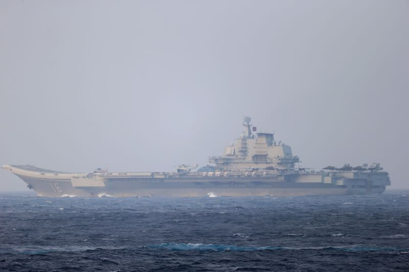 Chinese aircraft carrier Liaoning sails through the Miyako Strait near Okinawa on its way to the Pacific in this handout photo