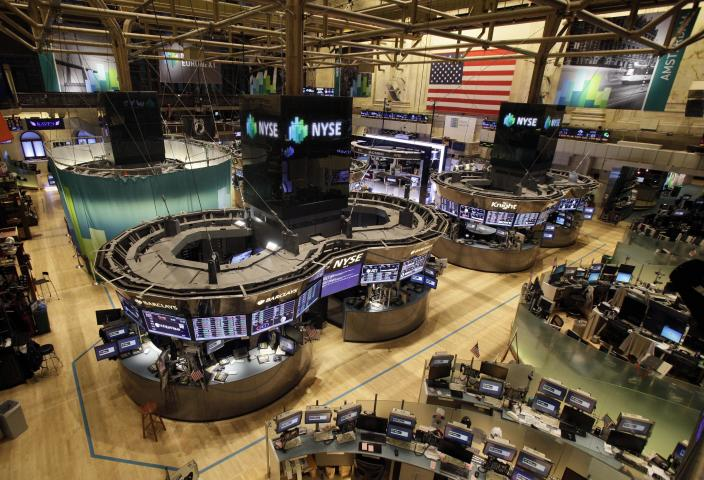The floor of the New York Stock Exchange is empty of traders, Monday, Oct. 29, 2012, in New York. All major U.S. stock and options exchanges will remain closed Monday with Hurricane Sandy nearing landfall on the East Coast. Trading has rarely stopped for weather. A blizzard led to a late start and an early close on Jan. 8, 1996, according to the exchange's parent company, NYSE Euronext. The NYSE shut down on Sept. 27, 1985 for Hurricane Gloria. (AP Photo/Richard Drew)