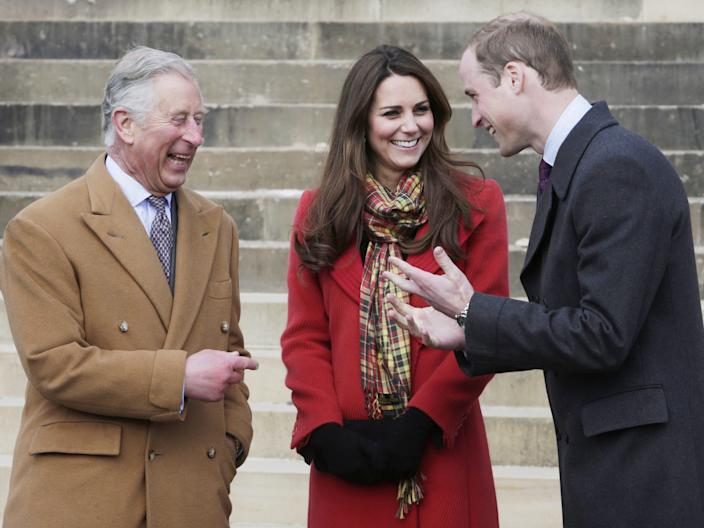 Prince Charles laughs with Kate Middleton and Prince William.