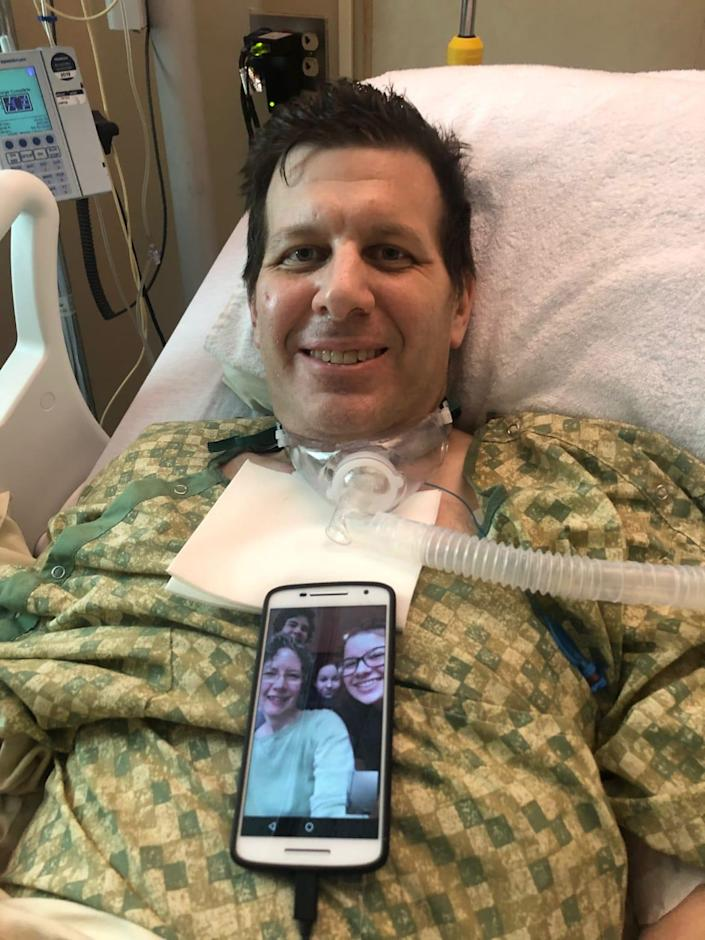 """<div class=""""inline-image__caption""""> <p>Edward in the hospital, one day released from the ICU, enjoying his first FaceTime interaction with his family (seen on phone) since he woke up.</p> </div> <div class=""""inline-image__credit""""> Courtesy Yasmeen Al-Shehab, Holy Name nurse </div>"""