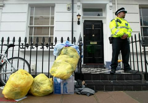 Police guard the Pimplico property where Gareth Williams's decomposed body was found - Credit: REUTERS/Luke MacGregor