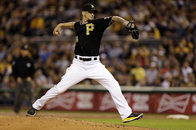 Pittsburgh Pirates starting pitcher A.J. Burnett (34) delivers during the third inning of a baseball game against the San Diego Padres in Pittsburgh Monday, Sept. 16, 2013. (AP Photo/Gene J. Puskar)