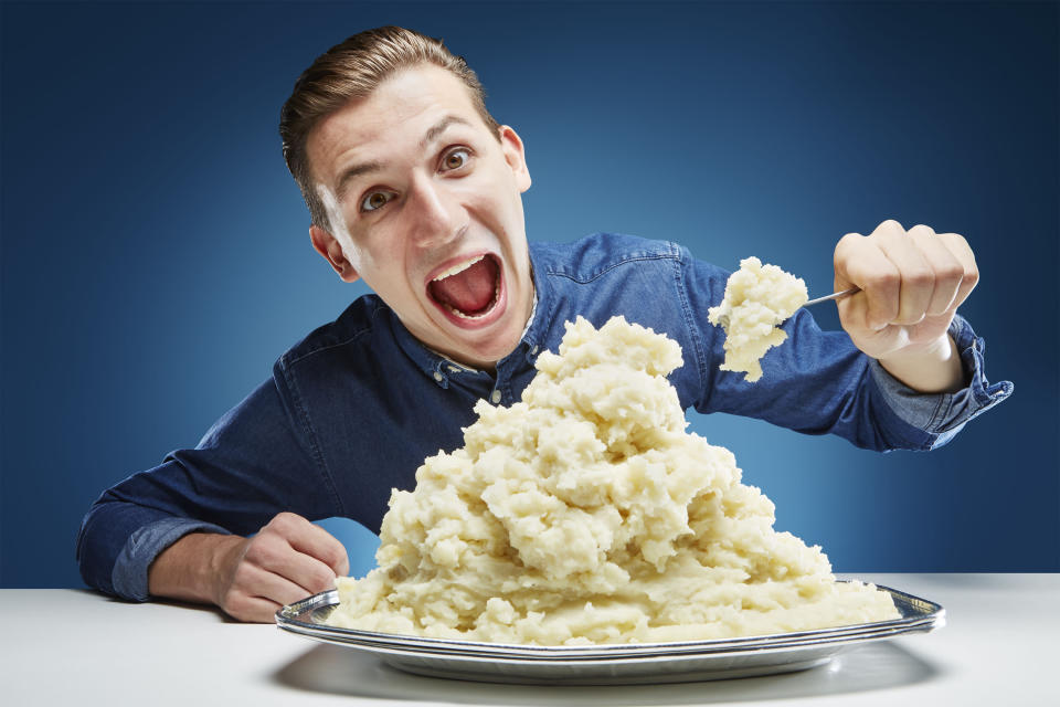 <p>When he's not guzzling on mustard, Andre Ortolf can also be found competing in mashed potato eating – another achievement he's won. He managed to consume 893g (31.5 oz) in 60 seconds. (PA) </p>
